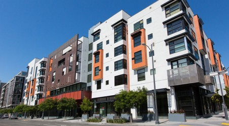 Market-rate apartments in a seven-story courtyard building in Mission Bay